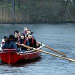 The Virgin Media Apprentice team rowing hard